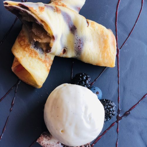 Dessert at the eCHo Restaurant Zurich: Crêpes with rhubarb-strawberry compote and vanilla ice cream